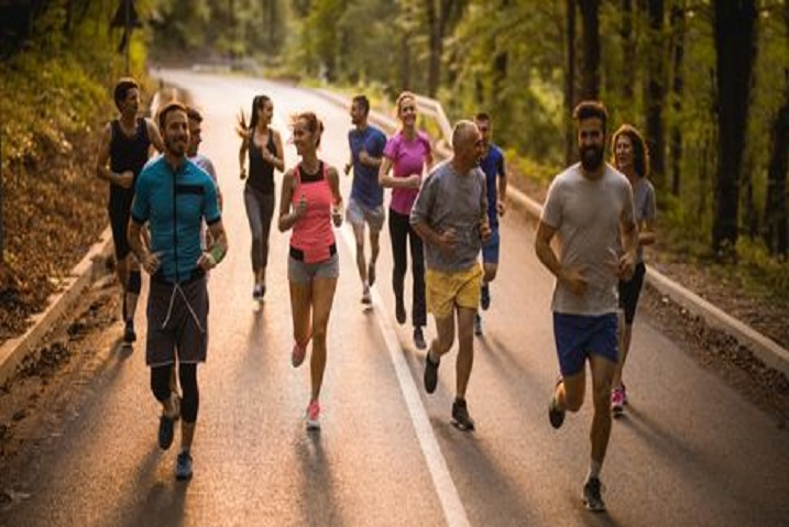 This image has an empty alt attribute; its file name is large-group-of-athletes-talking-while-having-a-road-royalty-free-image-1568746096-2.jpg